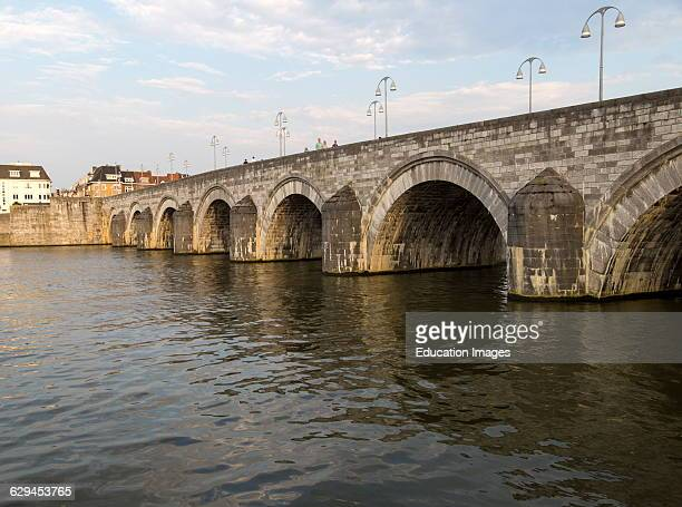 Evening light historic bridge River Maas or Meuse Maastricht Limburg province Netherlands