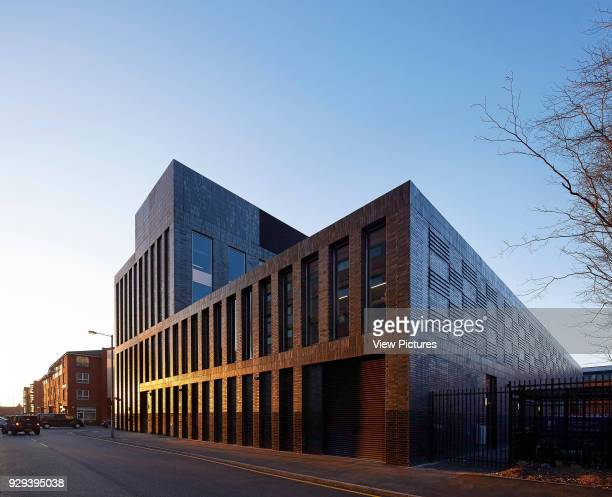Evening light on building facade. MMU Student Union, Manchester, United Kingdom. Architect: Feilden Clegg Bradley Studios LLP, 2015.