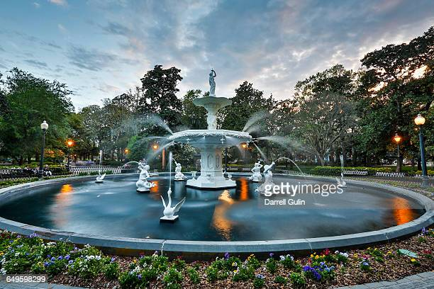 evening light on fountain in forsyth park - savannah stock pictures, royalty-free photos & images