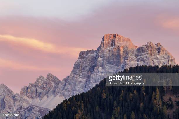 evening light on the mountains near to selva di cadore, italy. - belluno stock pictures, royalty-free photos & images
