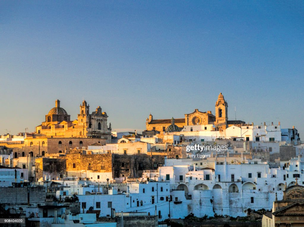 Evening light on the white old town : Stock Photo