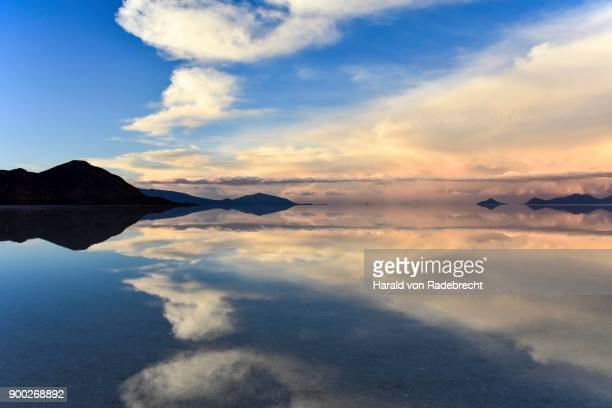 Evening mood, mountains with reflection in the lake, water flooded salt lake, Salar de Uyuni, Altiplano, Bolivia