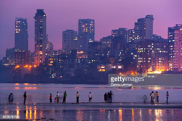 Evening on Chowpatty Beach on Marine Drive, known as the Queen's Necklace due to sparkling line of lights on the road