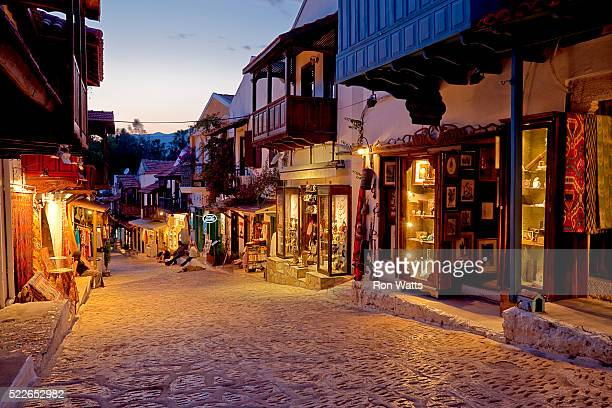evening on main shopping street in kas village in turkey - kas stock pictures, royalty-free photos & images