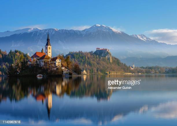 evening on the lake bled - slovenia stock pictures, royalty-free photos & images