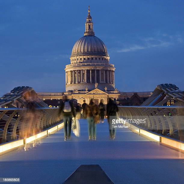 Evening on the Thames, London, UK. Millennium Bridge, pedestrian bridge over the Thames river in London. St Paul's cathedral in background. Blurred...