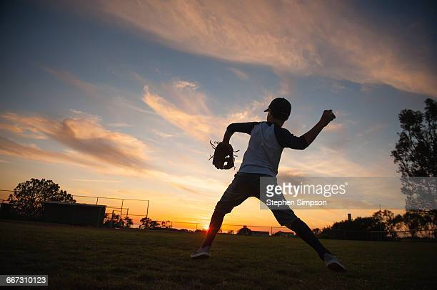 evening practice at the little league field - little league stock pictures, royalty-free photos & images