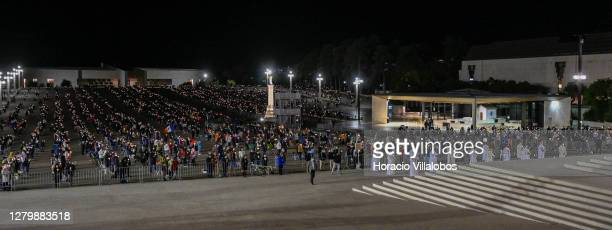 Evening procession of candles at the sanctuary on the first day of the ceremonies in which Catholics celebrate what they believe was the sixth and...