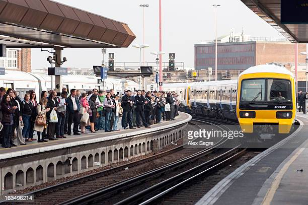CONTENT] Evening rush hour commuters waiting on crowded platform at London Bridge train station England UK