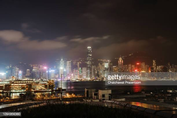 evening scene of hong kong city - hong kong stock pictures, royalty-free photos & images
