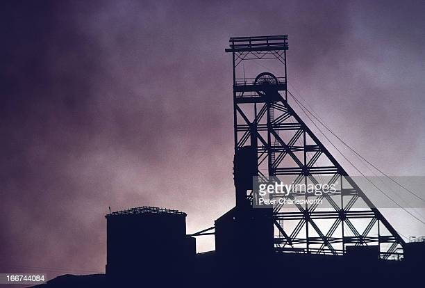 Evening scene of the lift mechanism for a mineshaft lift at one of the mines in Mount Isa where coal and iron ore are mined The pollution is smoke...