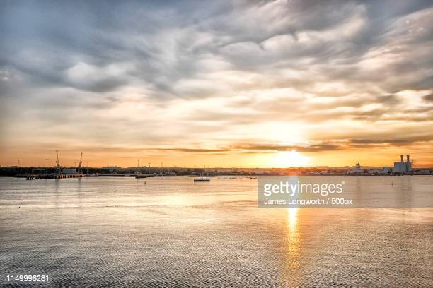 evening skies - southampton england stock pictures, royalty-free photos & images