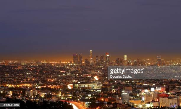 evening sky over the los angeles downtown city skyline - carson california stock pictures, royalty-free photos & images