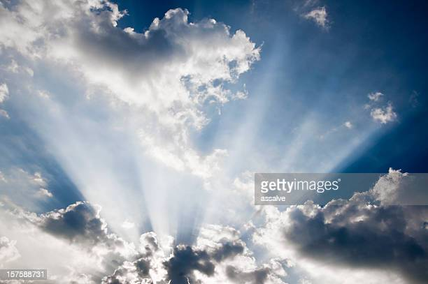 evening sky with awe sunbeams through cloudscape - appearance stock pictures, royalty-free photos & images