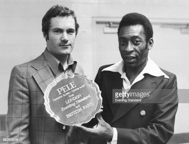 Evening Standard journalist Michael Hart presents Pele with an engraved silver salver to mark his retirement after his last match in New York 1st...