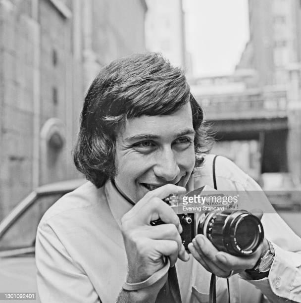 Evening Standard photographer Michael Fresco with a Nikon camera, UK, 30th July 1973.