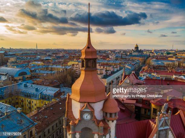 evening st.petersburg air view with rooftops and bell tower on a front view - san petersburgo fotografías e imágenes de stock