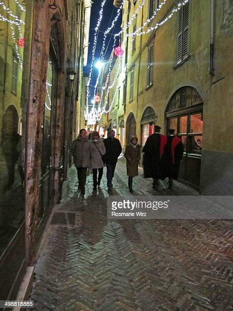 CONTENT] Evening stroll in Via Gombito the main walking street in Bergamo medieval town