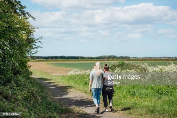 evening stroll together - fiancé stock pictures, royalty-free photos & images
