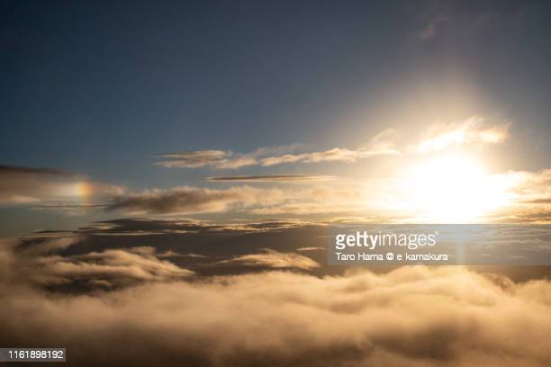 evening sun on clouds in japan sunset time aerial view from airplane - taro hama ストックフォトと画像
