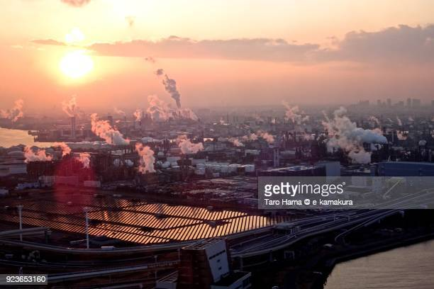 Evening sun on factory area in Kawasaki city in Kanagawa prefecture in Japan sunset time aerial view from airplane