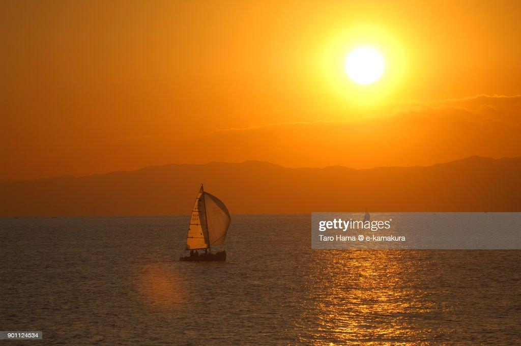 Evening sun on Izu Peninsula and a yacht on Sagami Bay in Kanagawa prefecture in Japan : ストックフォト