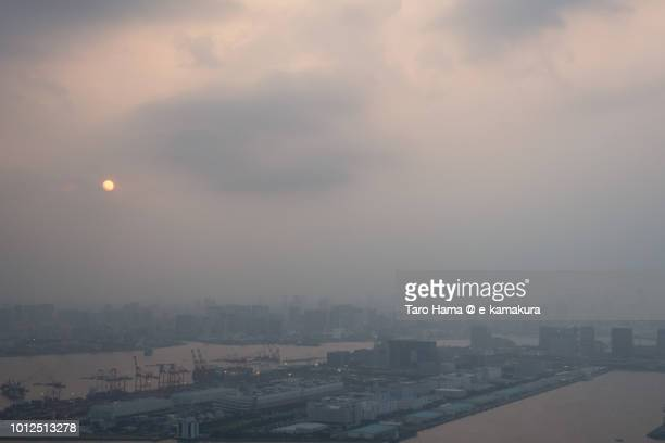 Evening sun on Tokyo Bay and city in Japan sunset time aerial view from airplane