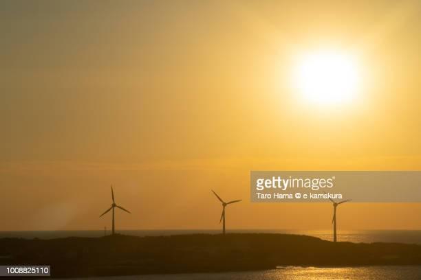 Evening sun on wind power station in Sakai city in Yamagata prefecture in Japan