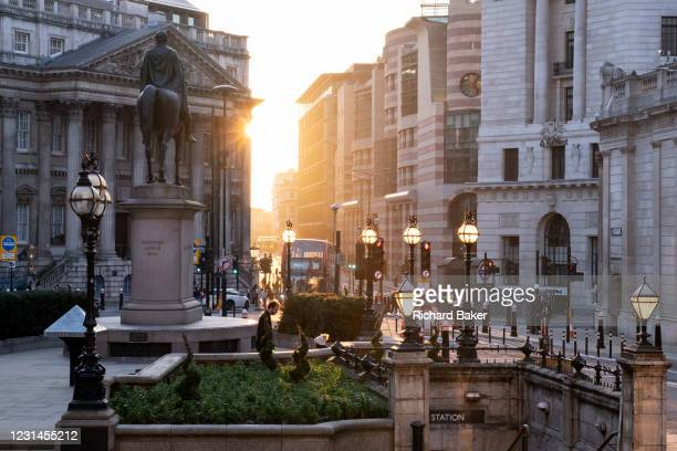 Evening sunlight illuminates the Bank Triangle junction during a much quieter evening rush-hour during the third lockdown of the Coronavirus...