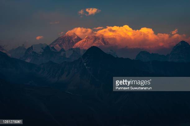 evening sunset light over everest and nuptse mountain peak view from gokyo ri in everest base camp trekking route, himalaya mountains range in nepal - gokyo ri ストックフォトと画像