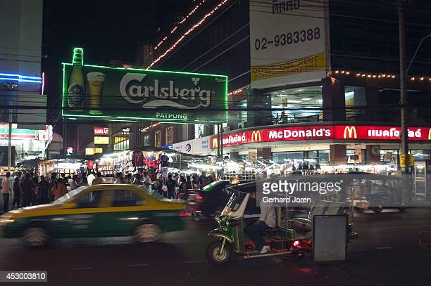 Evening traffic streams past the entrance to the infamous red light district of Patpong in central Bangkok The Thai capital has become renowned for...
