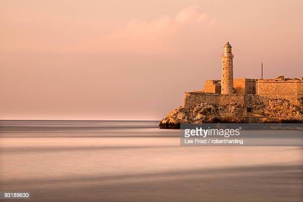 Evening view from The Malecon towards the Castillo de San Salvador de la Punta, Havana, Cuba, West Indies, Central America