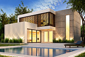 Evening view of a modern house with swimming pool