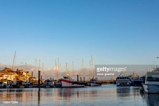 evening view of boats moored in bridlington harbour on the east coast of england. - bridlington stock pictures, royalty-free photos & images