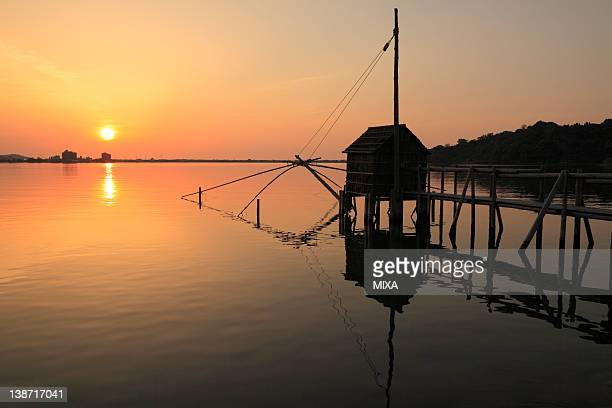 evening view of lake togo, yurihama, tottori, japan - tottori prefecture stock photos and pictures
