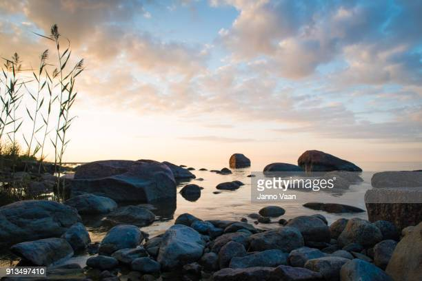 evening view of the sea - boulder rock stock pictures, royalty-free photos & images