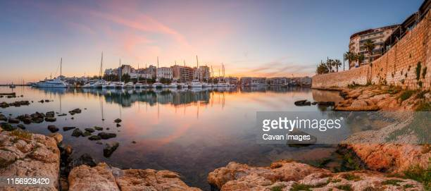 evening view of zea marina in athens, greece. - piraeus stock photos and pictures