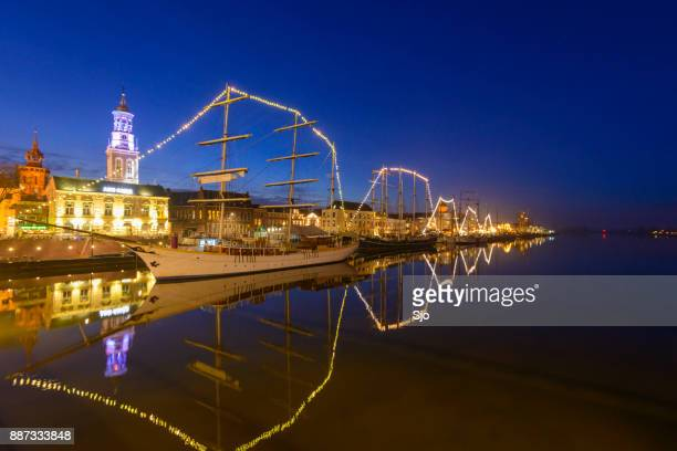 Evening view on the skyline of Kampen with the classic sailing ship Stedemaeght