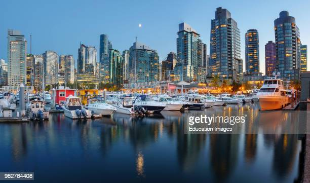 Evening views of city skyline from harbor Vancouver British Columbia Canada