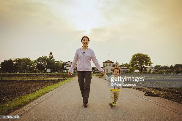 evening walk hand in hand - peter lourenco stock pictures, royalty-free photos & images