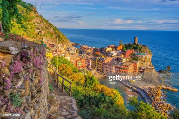 evening walk into vernazza, cinque terre, liguria at dusk - cinque terre stock pictures, royalty-free photos & images
