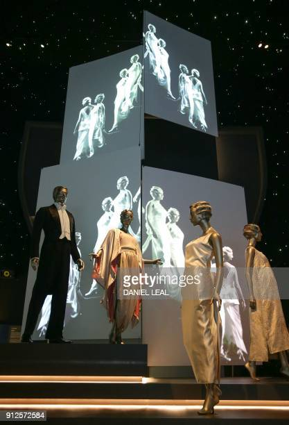 Evening wear from 19131950 is on display at a new exhibition 'Ocean Liners Speed and Style' at the Victoria and Albert Museum in west London on...