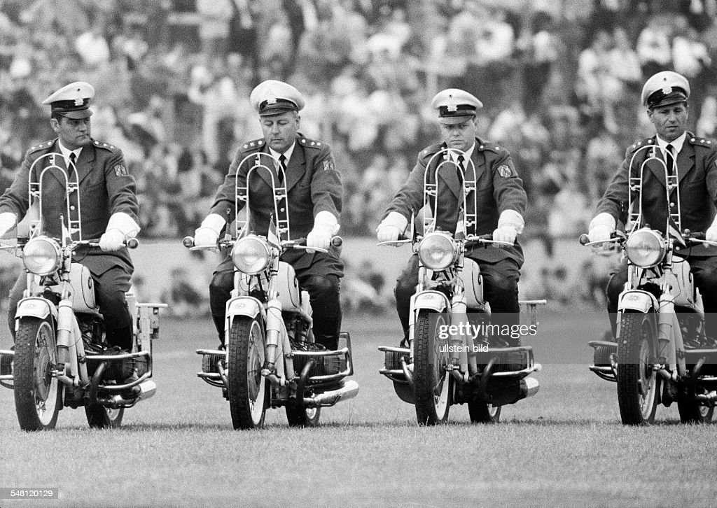 event, 3rd International Police Sports and Music Festival 1966 in the Niederrhein Stadium in Oberhausen, four policeman on motorbikes drive in formation, aged 30 to 50 years, D-Oberhausen, Ruhr area, North Rhine-Westphalia - 09.07.1966 : News Photo