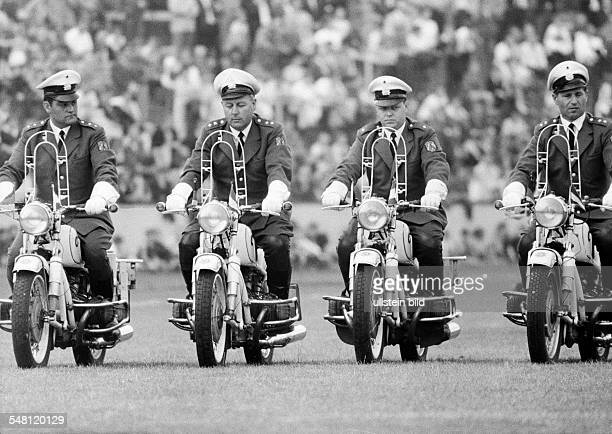event 3rd International Police Sports and Music Festival 1966 in the Niederrhein Stadium in Oberhausen four policeman on motorbikes drive in...