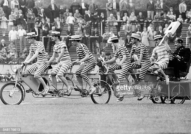 event 3rd International Police Sports and Music Festival 1966 in the Niederrhein Stadium in Oberhausen humour seven humorists on one bicycle...
