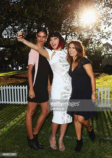 Event ambassadors Samantha HarrisDami Im and Ada Nicodemou pose during a 'You Beauty' campaign consumer event prior to a world record attempt at the...