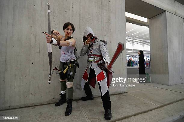Event attendees Laura Kroft from the Tomb Raider and Enzio Auditore from Asencion Creed attend the 2016 New York Comic Con Day 1 on October 6 2016 in...