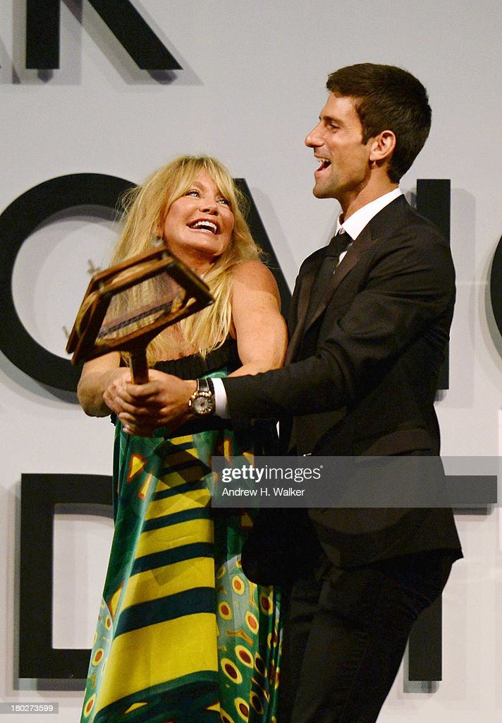 Event Chair Goldie Hawn and Founding Chairman Novak Djokovic speak on stage at the Novak Djokovic Foundation New York dinner at Capitale on September 10, 2013 in New York City.