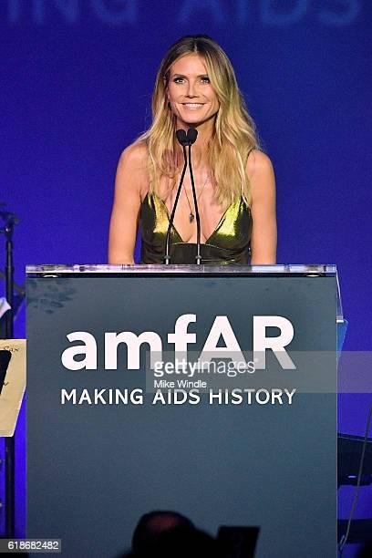 Event chair Heidi Klum speaks onstage at amfAR's Inspiration Gala Los Angeles at Milk Studios on October 27 2016 in Hollywood California