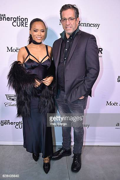 Event chair Serayah and amfAR board chairman Kenneth Cole attend the 2016 amfAR GenerationCure Holiday Party at Cadillac House on December 7 2016 in...